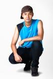 Seduta del ragazzo dell'adolescente Fotografie Stock