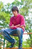 Seduta dell'adolescente Fotografie Stock