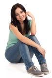 Seduta dell'adolescente fotografia stock