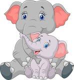 Seduta dell'elefante della madre e del bambino del fumetto isolata su fondo bianco Fotografia Stock