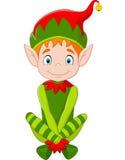 Seduta dell'elfo di Natale felice del fumetto Fotografia Stock