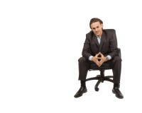 Seduta dell'uomo d'affari fotografie stock libere da diritti