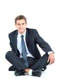 Seduta dell'uomo di affari Fotografie Stock