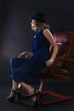 Seduta della donna Immagine Stock