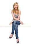 Seduta della giovane donna Immagine Stock Libera da Diritti