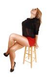 Seduta della giovane donna. Fotografie Stock