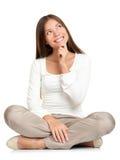 Seduta di pensiero della donna del pavimento isolata Immagini Stock Libere da Diritti
