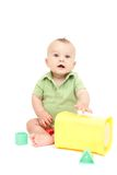 Seduta e gioco del bambino Immagine Stock