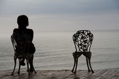 Seduta e pensare Fotografia Stock