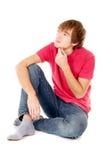 Seduta e pensiero dello studente del tirante Fotografia Stock Libera da Diritti