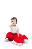 Seduta ed indicare della ragazza di natale felice Fotografie Stock Libere da Diritti