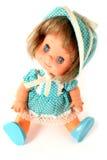 Seduta felice della bambola della ragazza Fotografie Stock