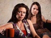 Seduta preoccupata delle donne Fotografia Stock