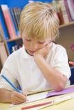 seduta primaria dello scolaro del codice categoria Fotografia Stock Libera da Diritti