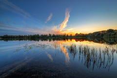 See bei Sonnenuntergang Stockfoto