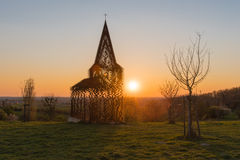 See-through church Borgloon. See through church Borgloon at sunset royalty free stock images