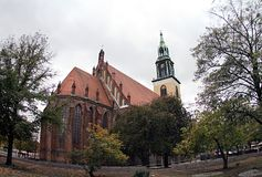 Germany St. Mary Church, Berlin. We see the church through trees and branches stock photos