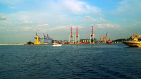 We see cranes seaport passing the port. Evening time stock footage