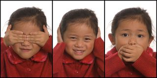 See Hear and Speak No Evil. A young girls plays out See NO Evil, Hear no Evil, and Speak no Evil royalty free stock images