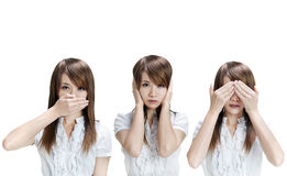 See, hear, speak no evil. Woman showing different gesture on white background stock photography