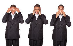 See Hear Speak No Evil - businessman. Isolated studio shot of an African American businessman in the See No Evil, Hear No Evil, Speak No Evil poses stock photos
