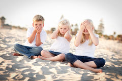 See, Hear and Speak No Evil Children Outside. See, Hear and Speak No Evil Posing Children Outside at the Beach stock photos
