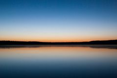 See im Sonnenuntergang Lizenzfreies Stockbild
