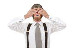 See no evil. Businessman in monkey mask Stock Images