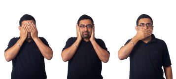 See no evil. Hear no evil, speak no evil - Asian man, isolated in white Stock Image