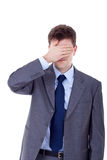 See no evil. Business man making the see no evil gesture over white Royalty Free Stock Images