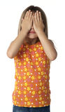 See No Evil. Five year old girl covering eyes with hands. White background Stock Image