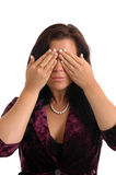 See No Evil. A pretty young woman covering her eyes in see no evil stock photos