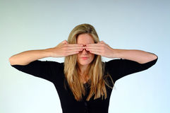 See no Evil. Woman with both hands over her eyes Stock Images