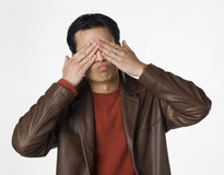 See no evil. Young Filipino man covers his eyes Stock Photography