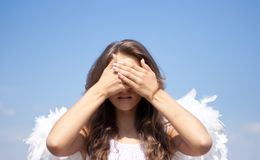 See no evil, angel girl and sky Stock Image
