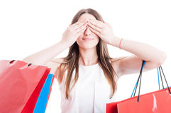 See no evil concept with smiling shopaholic woman Stock Photography