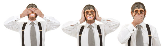 See no evil, Hear no evil, Speak no evil. Businessmen in monkey masks - see no, hear no evil, speak no evil Royalty Free Stock Photography