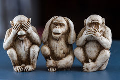 See no evil, hear no evil, speak, no evil. Close up of hand small statues with the concept of see no evil, hear no evil and speak no evil stock image