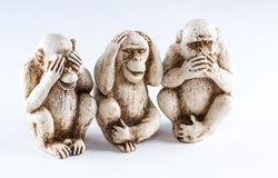 See no evil, hear no evil, speak, no evil. Close up of hand small statues with the concept of see no evil, hear no evil and speak no evil stock images
