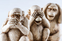 See no evil, hear no evil, speak, no evil. Close up of hand small statues with the concept of see no evil, hear no evil and speak no evil stock photo