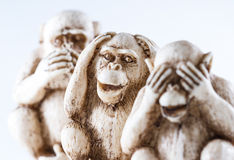 See no evil, hear no evil, speak, no evil. Close up of hand small statues with the concept of see no evil, hear no evil and speak no evil royalty free stock photo