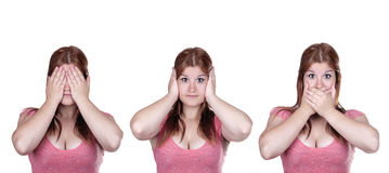 See No Evil, Hear No Evil, Speak No Evil poses. Isolate studio shot of a casually dressed young adult woman in the See No Evil, Hear No Evil, Speak No Evil Stock Photo