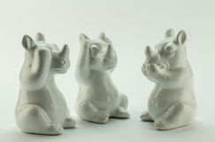See no evil, hear no evil, speak no evil, rhino objects on white Royalty Free Stock Photo