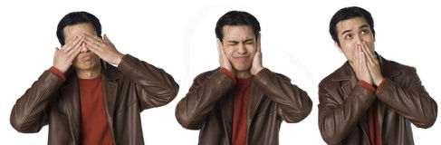 See no, Hear no, Speak no Evil. Young Filipino man covers his eyes, ears, mouth Royalty Free Stock Photos