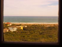 Look from a lighthouse window. We see the ocean as far as the eye can see. It was a nice day. Ponce Inlet Lighthouse, Florida, U.S.A .; winter 2016 royalty free stock images