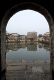See the pond and old house through the arch Royalty Free Stock Photo