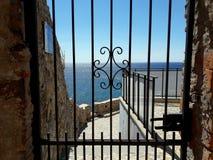 See the sea through a gate. The sea seen through a gate Royalty Free Stock Photos