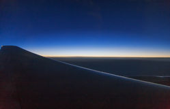See the sunrise on the plane Royalty Free Stock Photo