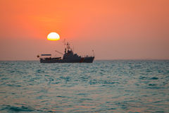 The see sunset at the coast of Cartagena town in Colombia. The see sunset with big boat at the coast of Cartagena town in Colombia stock image