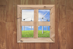 See wind power station through wooden window Stock Photo